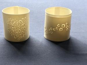 Delphine Roques,  Sakura Tealight Holder.  Porcelain paper clay ~7cm by 7cm  £22  Each