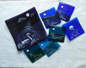 Wendy Lund, MOONSHINE SERIES  Glass fused with metallic intrusions; painted and refired.Plates – 1 x 15x15cms; 2x 10cms, Coasters x4. £80 - for the set