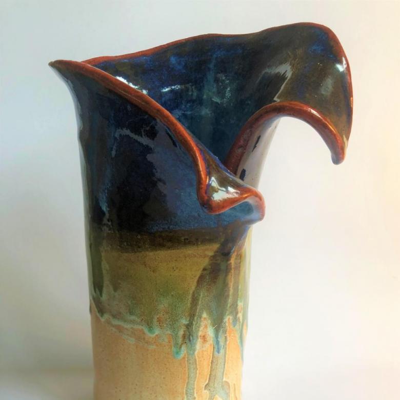 Janet Imrie,  Unfurling vase. Pottery 30cn x 10 cm. NFS